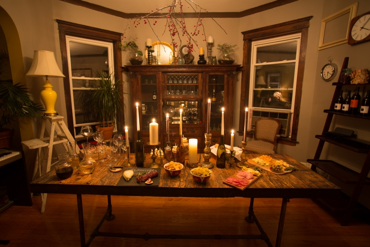 Table is all set! We just made a centerpiece of old candle sticks and old wine bottles.