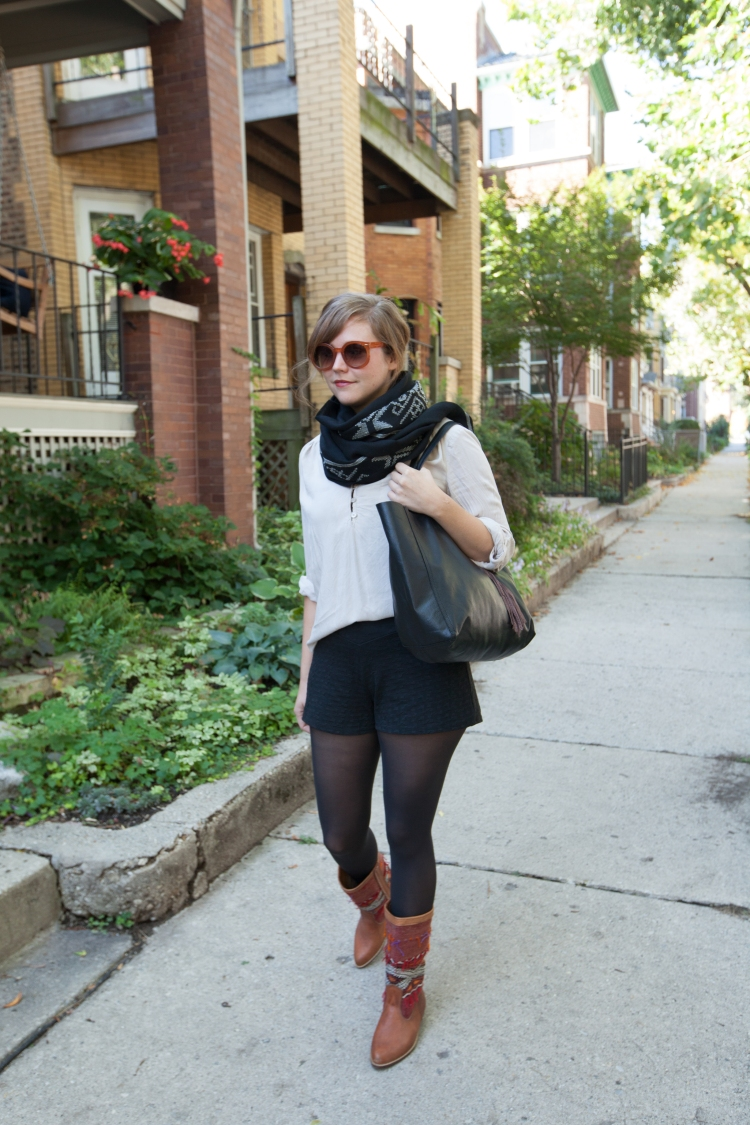 annie in black shorts with tote