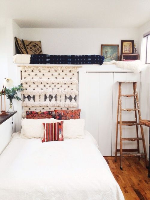 The use of this blanket is both functional and aesthetically pleasing. By covering a closet, it looks like the bed is made for that corner. The wedding blanket can easily be lifted up to access the closet. This is a perfect solution for a small space where you need to get crafty with design and practicality.